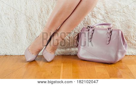 Pair of beige women's high-heeled shoes Feet bag powder color
