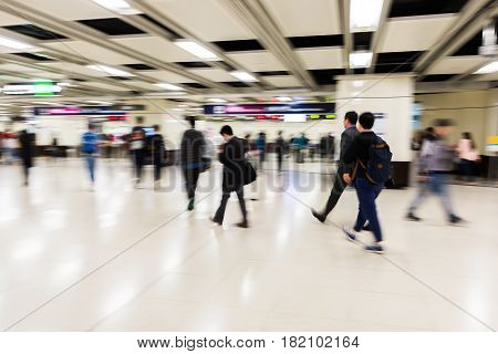 People In An Underground Station In Motion Blur