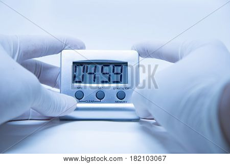Timer laboratory testing equipment in blue tone
