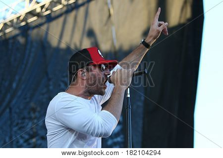 FRISCO, TX-APR 24: Singer Sam Hunt performs onstage during the 2016 Off The Rails Music Festival - Day 2 on April 24, 2016 at Toyota Stadium in Frisco, Texas.