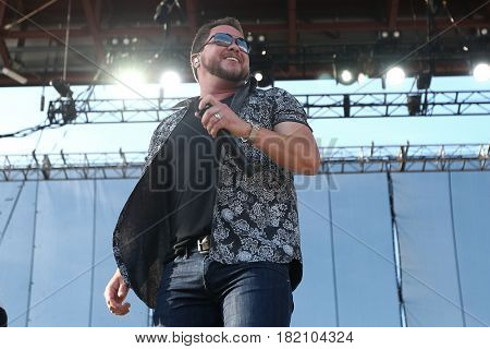 FRISCO, TX-APR 23: Singer Mike Eli of the Eli Young Band performs onstage during the 2016 Off The Rails Music Festival - Day 1 on April 23, 2016 at Toyota Stadium in Frisco, Texas.