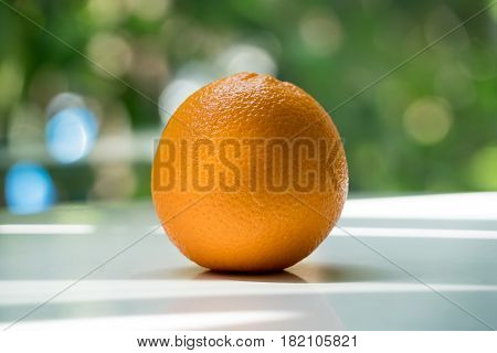 The organic orange isolated on green blurred background