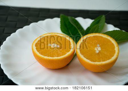 The organic slice orange on white plate - isolated