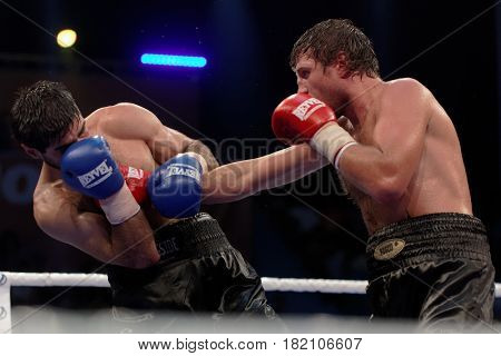 ODESSA, UKRAINE - JULY 21, 2012: Fight Valeriy Brazhnyk (right) vs Igor Fanian. The tournament was organized by the company K2 Promotions of brothers Klichko