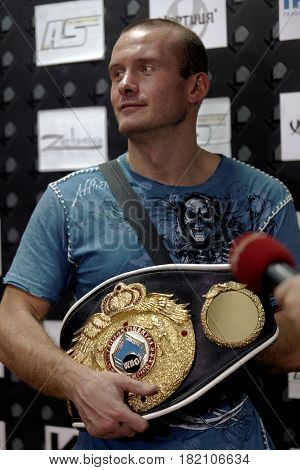 ODESSA, UKRAINE - JULY 21, 2012: Vyacheslav Uzelkov with belt after the fight with Mohamed Belkacem for WBO Inter-Continental light heavyweight title