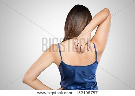 Woman scratching her itchy back with allergy rash Shoulder idea with Healthcare And Medicine Beautiful girl with skin problem concept