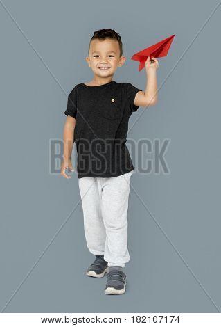 Little Boy Holding Paper Plane Studio Portrait