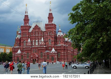 MOSCOW, RUSSIA - JULY 2, 2014: People walking in front of the State Historical museum on the Red square. The museum found in 1872 but the building was erected in 1875-1881