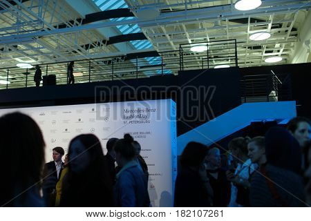 ST. PETERSBURG, RUSSIA - APRIL 1, 2017: People talking in the hall between fashion shows during Mercedes-Benz Fashion Day St. Petersburg. It is one of the most popular fashion events of the city