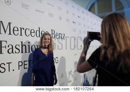 ST. PETERSBURG, RUSSIA - APRIL 1, 2017: People make photos between fashion shows during Mercedes-Benz Fashion Day St. Petersburg. It is one of the most popular fashion events of the city