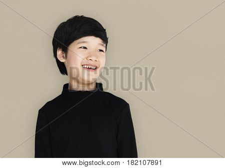 Asian ethnicity boy with a black shirt
