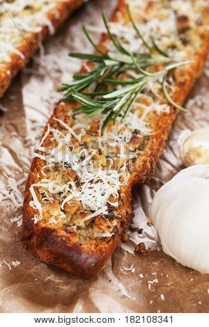 Oven roasted garlic bread with parmesan cheese and rosemary