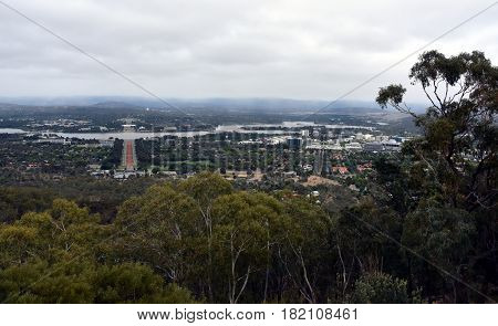 Panoramic view of Canberra Australia in daytime from Mount Ainslie featuring the Australian War Memorial Lake Burley Griffin Molonglo River Old Parliament House and New Parliament House.