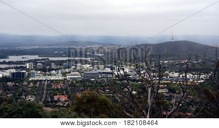 Panoramic view of Canberra Australia in daytime from Mount Ainslie featuring Lake Burley Griffin Black Mountain and Telstra Tower.