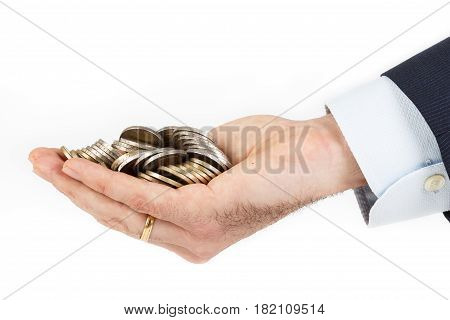 Businessman hand holding a pile of euro coins on white bacgrounds. Business concept.