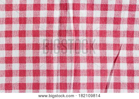 Red linen picnic tablecloth. Texture of a red and white checkered picnic blanket.