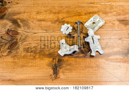 Tin Cookie Cutters Sitting on Wooden Table With Knots