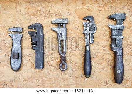 close up many different old tools hanging on wall
