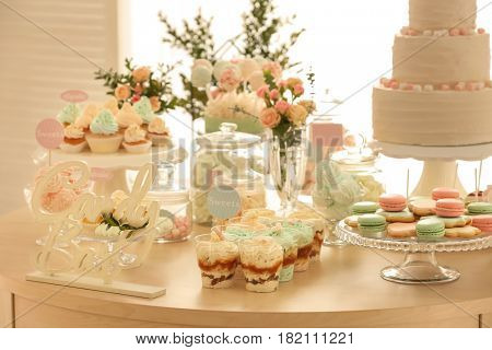 Table with sweets prepared for party