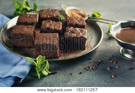 Metal tray with delicious cocoa brownies on table