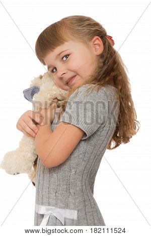 Happy little girl hugging soft toy . close-up - Isolated on white background