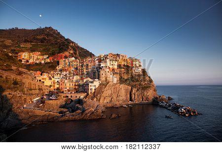 village of Manarola, Italy on the Cinque Terre coast at sunset