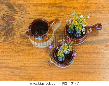 Three Pieces of Crockery With Small Flowers Sitting on Wooden Table
