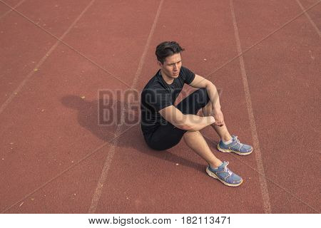 Elevated View, One Young Man, Resting Sitting, Running Tracks