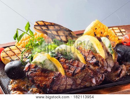 Delicious Beefsteak With Corn Orange Sweet  Potatoes On Wooden Platter
