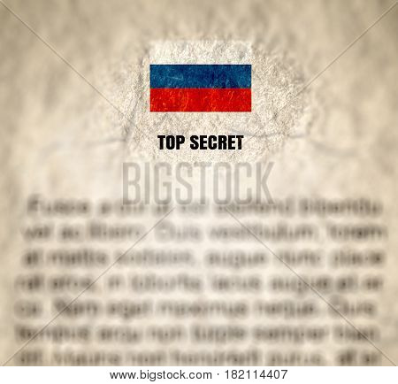 russian top secret document. crumpled paper textured with russian national flag