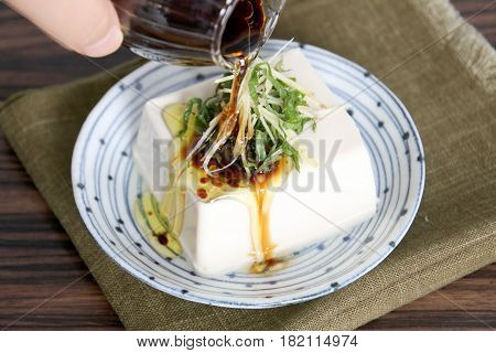 Special Tofu Cake With Oil And Onion On White Platter