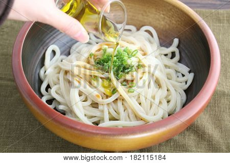 Ramen noodle with oil in bowl on table