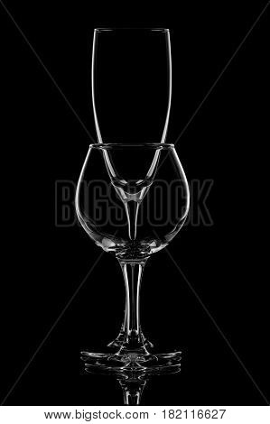 Group of empty wine glasses on black. Glassware