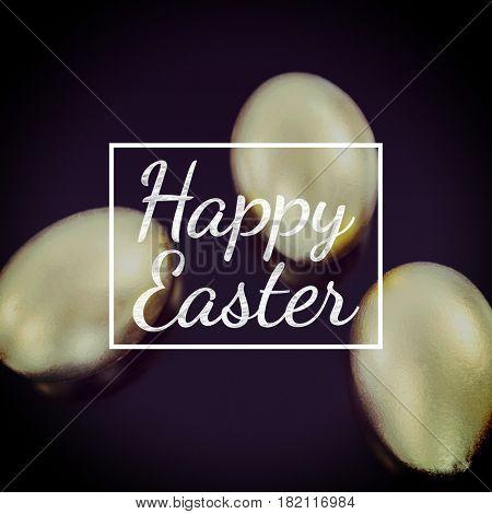 happy easter against golden easter eggs on black background