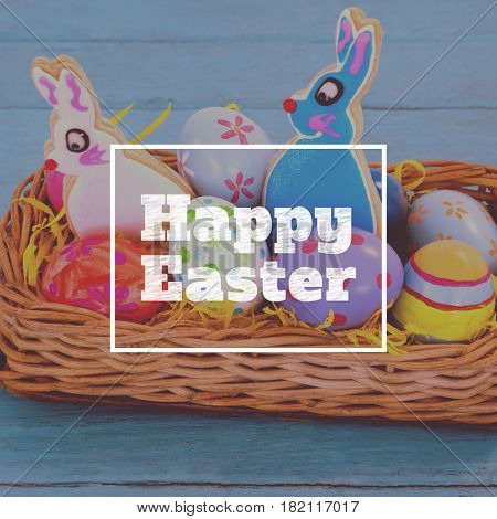 happy easter against various easter eggs served in wicker basket