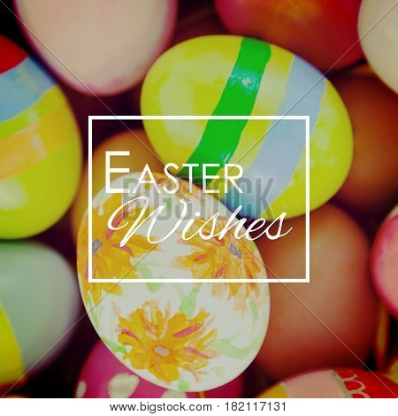 Easter greeting against colorful painted easter eggs