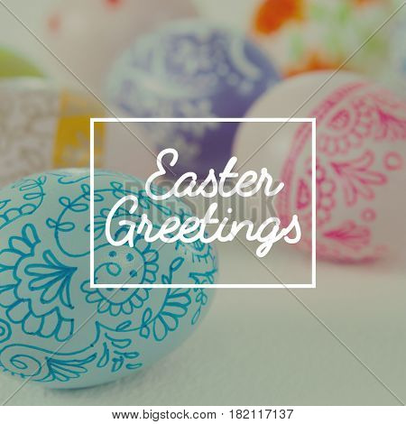 Easter greeting against colorful easter eggs on white background