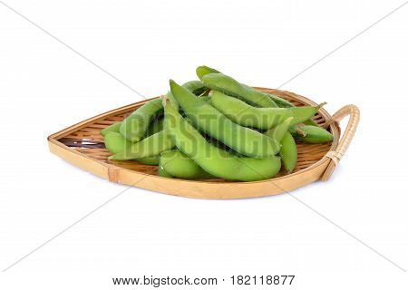boiled Japanese green soybeans (Edamame-Japanese text) in basket and on white background