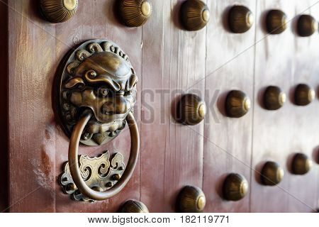 Traditional Chinese Door Handle And Knocker. Main Gate Of Temple