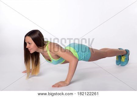 Fitness Woman In Sporswear Doing Pushup Exercises