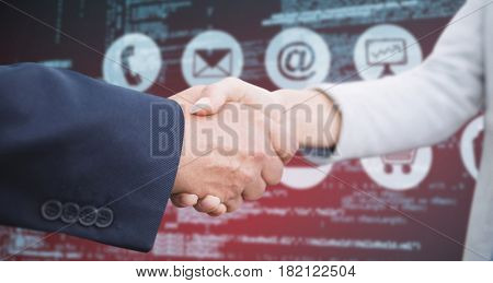 Corporate people doing handshake against composite image of blue codes
