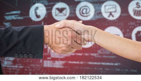 Businessman shaking hands with partner against composite image of blue codes