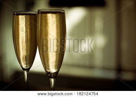 Close up two glasses of champagne celebration concept