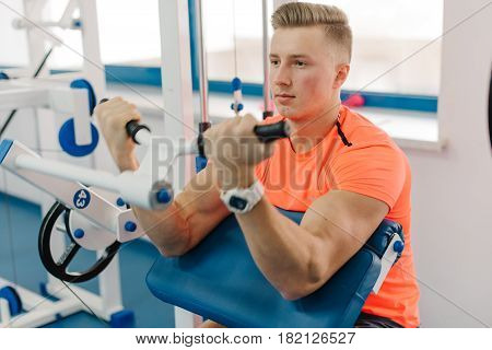 very power athletic guy bodybuilder developing definition of muscles of his hands