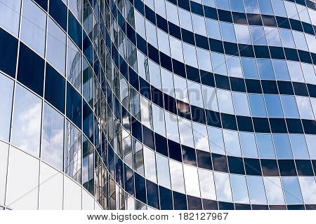 Modern Office Skyscraper With Glass Windows And Sky Reflection