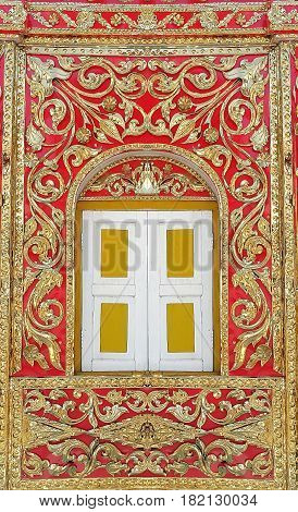 Burmese Style window decorated by gold color metallic embossed flower design Tak province Thailand