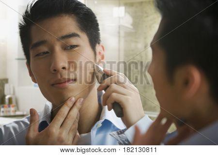 Korean man shaving