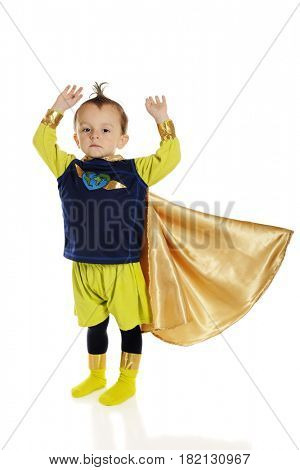 A serious preschool superhero, arms raised and cape flowing as he prepares for flight.  On a white background.