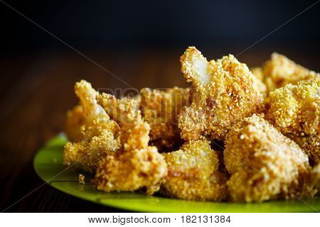 cauliflower baked in batter on a wooden table