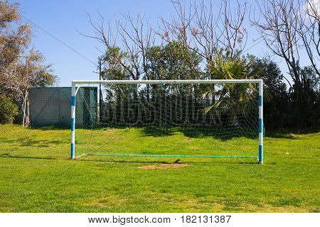 Soccer Goal with soccer field. Soccer football net background over green grass